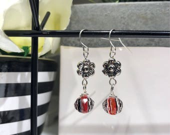 Flower dangle earrings with a hint of red