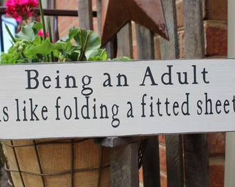 Being an Adult is like folding a fitted sheet, Wood sign, Funny sign, man cave sign, Mom sign, Adulting, Farmhouse Sign, Family Sign, Parent