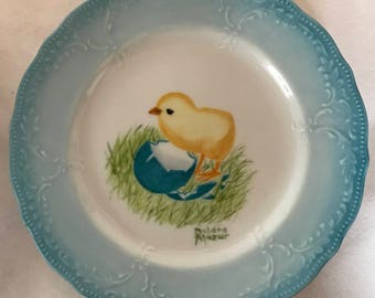 Baby chick on a decorative plate