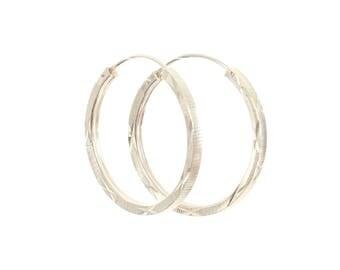 Sterling Silver Diamond Cut Hooped Earrings.