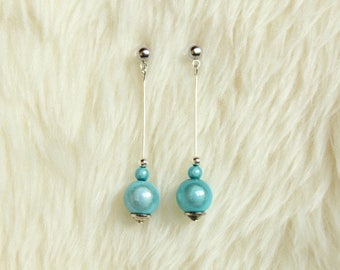 Long earrings on stem and blue magic pearls