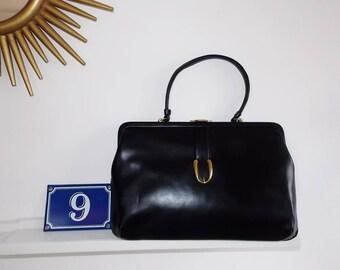 Vintage black faux leather clutch handbag