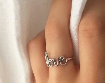 Silver 925 ring written Love faith