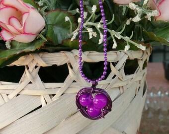 Purple wire wrapped birds nest pendant charm necklace
