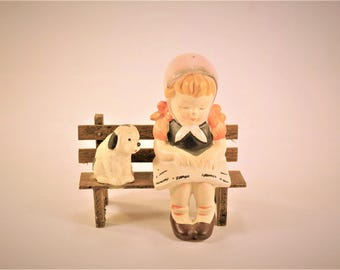 Little girl and dog on a bench figurine, porcelain statue,artmark collectables.