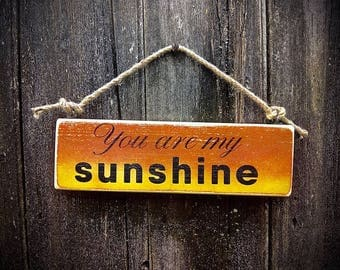 Handmade wooden sign with the words 'you are my sunshine'.