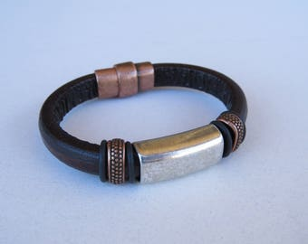 Leather bracelet with copper and silver components