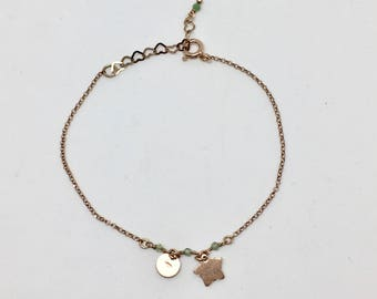 Rose gold plated bracelet with small pendants