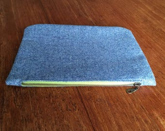 Navy wool clutch bag with bright green zip