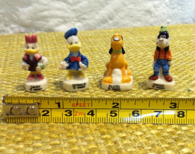 vintage beautiful porcelain walt disney figures miniature daisy, donald, pluto, dingo
