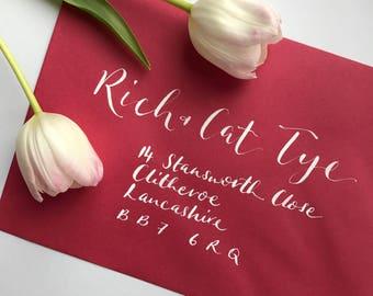 Hand lettered calligraphy envelope addressing - white ink