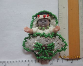 "American Indian - hand crafted baby doll ""papoose""."