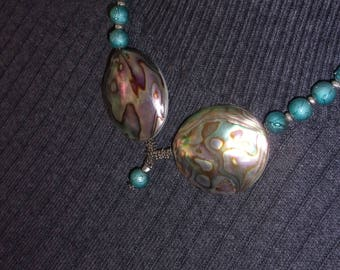 Twin abalone shells, hand painted teal glass beads.