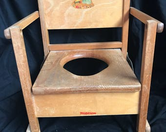 1950's vintage folding wooden potty chair. Made by Hedstrom.