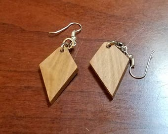 Hand made hardwood earrings. Crafted from salvaged shrubs that were damaged recently.
