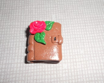 Romantic pendant: old diary and decorated with a red rose