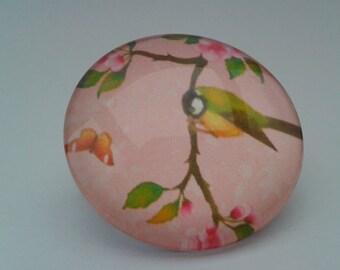 Glass cabochon brooch pink bird on a branch