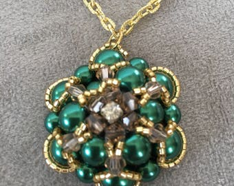 Green flower rose with gold embellishment pendant necklace on a gold chain.