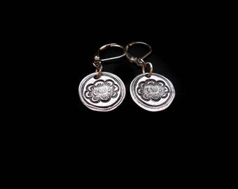 Steel lotus earrings