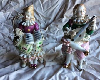Two Vintage Porcelain figurines.