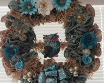 Burlap wreath with turquoise and blue flowers