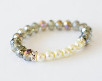 Bracelet with glass, pearls and rondel in silver stones.