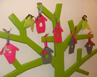 small birdhouses hanging pink and gray