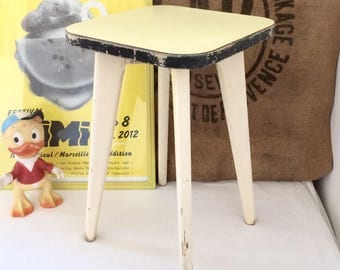 Old stool made of wood and formica covered yellow. Vintage 1950's