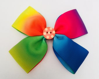 Rainbow double bow with button centre .