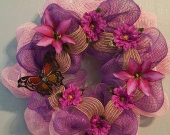 Purple pink with a butterfly wreath adding some flowers