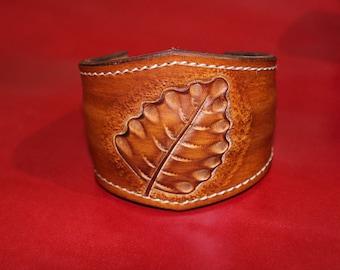 Embossed leather, closure way torque bracelet