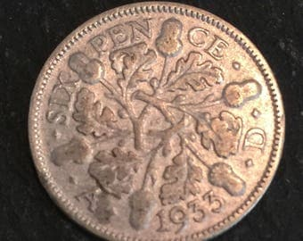 A 1933 King & Emperor George V .500 silver English sixpence coin