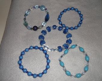 5 x acrylic blue stretchy bracelets