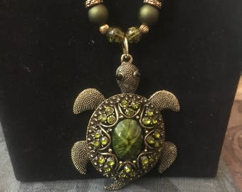 Green and gold frog pendant and beaded necklace and earrings set