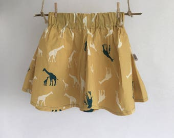 Skirt girl organic cotton mustard with giraffes.