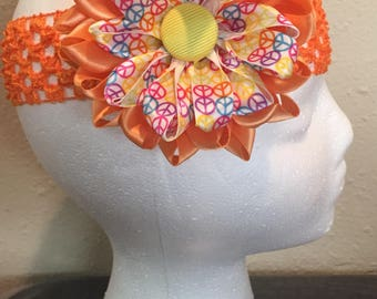 Orange flower hair bow with peace signs/ headband