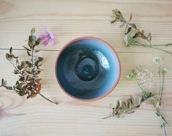 Clay bowl made on pottery wheel. Blue glaze.