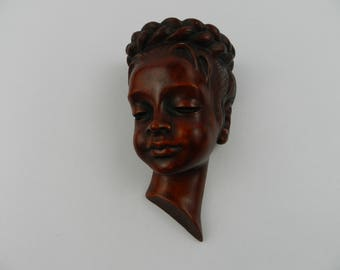 Wall mask of a girl - Achatit, Germany