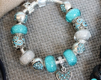 Pandora bracelet. Bracelet with hearts. Bracelet with crowns.