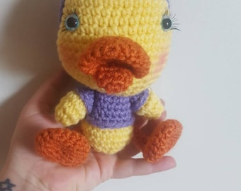 Handmade stuffed girly duckling