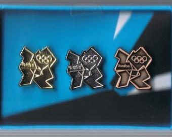 "London 2012 Olympics logo pins set of 3 boxed. Gold, Silver, Bronze. Miniature box set. 3"" wide 2"" high & 1"" deep."