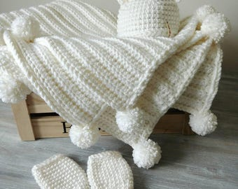 Pompom blanket set with matching bear hat and mittens.