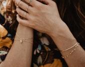 """Bague anneau fin en plaqué or hypoallergénque 18carat / 3micron et sa perle """"oeil"""""""