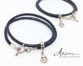 Winding bracelet in dark blue with anchor pendant