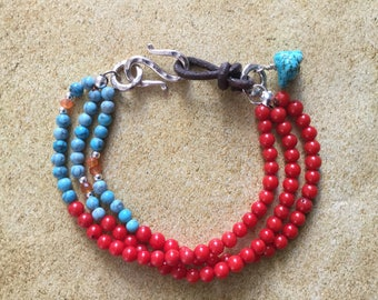 Multi strand bracelet of coral, turquoise, silver, tribe clasp with genuine leather