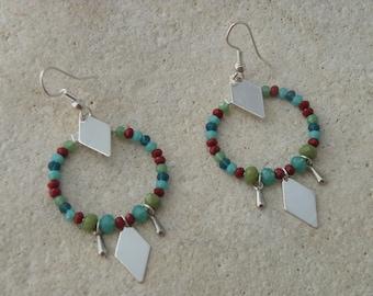 Creole earrings and glass beads