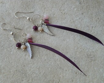 Pendants and beads and purple feather earrings