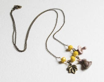 Into the wild necklace mustard yellow beads and rabbit, mushroom and leaf charms
