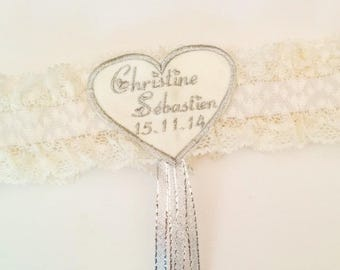Ivory garter with an embroidered heart with the names of newlyweds