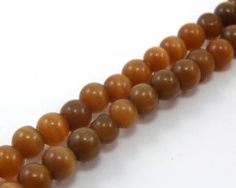 Set of 5 6 mm Brown cat eye glass beads